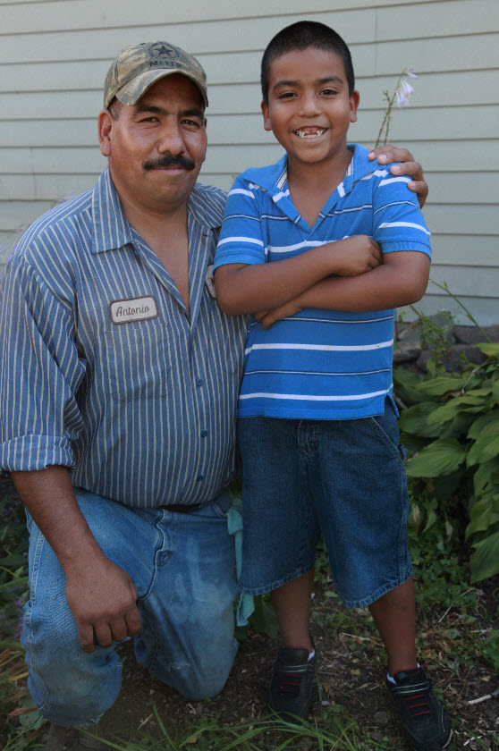 Migrant Hispanic father and son posing